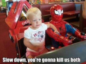 child riding with spiderman